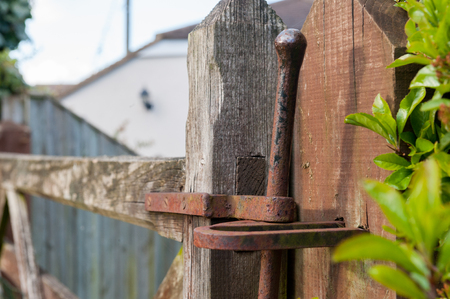 fence: Close up of a rusty metal pull gate lock