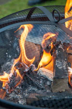 burned out: Close up of flames in a outside wood burner Stock Photo