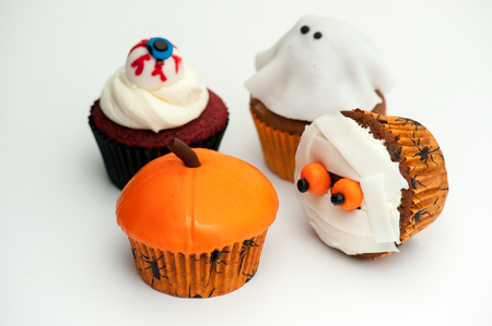 cup four: close up of four decorated Halloween cup cakes