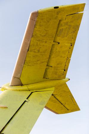 aerodynamic: large yellow air craft back tail
