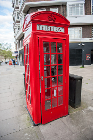red telephone: Traditional British red telephone box on street
