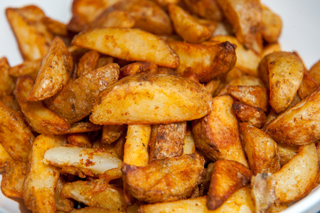 side order: cooked potato wedges ready to serve