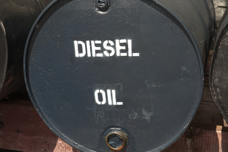 lubricate: large black metal oil drum for heavy machineary