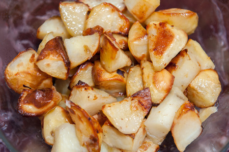 side order: cooked potato roasties ready to serve