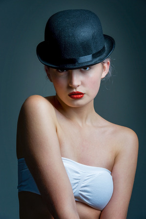 bowler hat: young lady posing in a black bowler hat