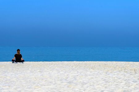 woman in black shirt sitting on white sand during time nature awesome nice new beautifully photo