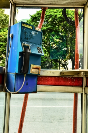 phone booth: Old fashioned Phone booth with door Stock Photo
