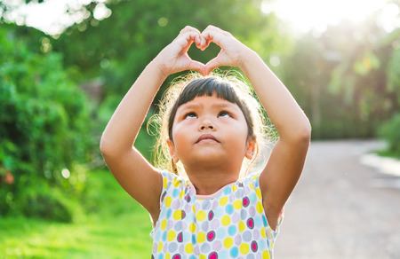 children look pass hand heart