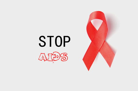 relaciones sexuales: Aids Awareness Red Ribbon. World Aids Day on white background