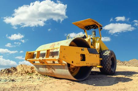 Construction asphalt roller closeup and blue sky background