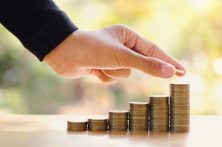 hand save money with stack money coin for growing graph your business