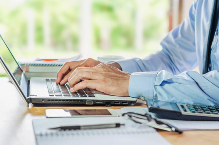 Businessman using computer laptop Financial Report Revenue Statistical Accounting Concept