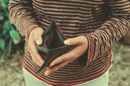 hipster woman holding an empty wallet, she has no money