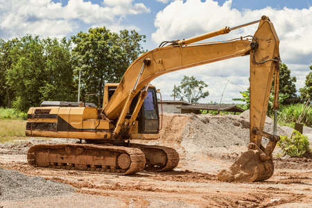 excavator on the workplace construction road at countryside Stock Photo