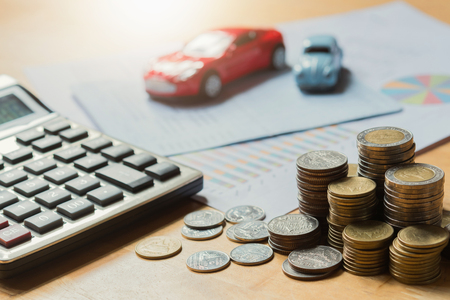 Toy car with calculator and money. concept business finance and insurance Stock Photo