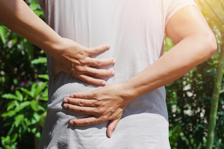 man runing with back pain at outdoor