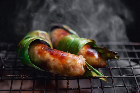 Grilled sausage herb on fire