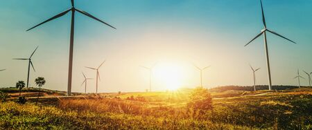 concept idea eco power energy in nature. wind turbine on hill and sunset