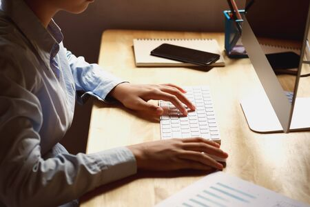 businesswoman working on desk using laptop for check data of finance in office Stok Fotoğraf - 130721695