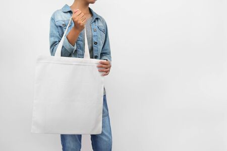 hipster woman holding eco fabric bag isolate on white background Stok Fotoğraf
