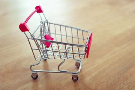 shopping cart on table and sunlight background shopping online concept of modern market