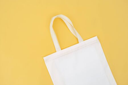 fabric bag isolate on yellow background