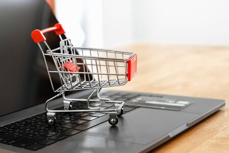 shopping cart and credit card on laptop in office.  concept shopping online Stok Fotoğraf
