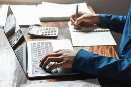businessman working in office with using a calculator to calculate the numbers finance accounting concept Stok Fotoğraf