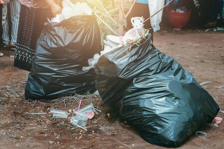 garbage in  plastic black in park Stok Fotoğraf