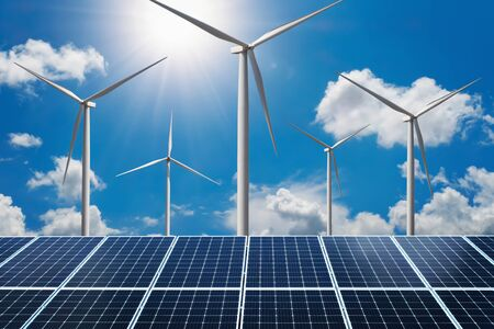 concept clean energy power. solar panel with wind turbine and blue sky background