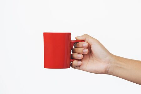 hand holding red coffee cup isolate on white background