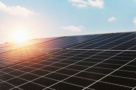 solar cell panel with blue sky and sunset. energy cleaning in nature concept Stockfoto