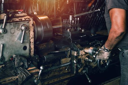 close up worker turning steel in factory