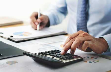 businessman working with using calculator in office. finance and accounting concept