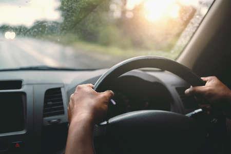 closeup hand driver car on road