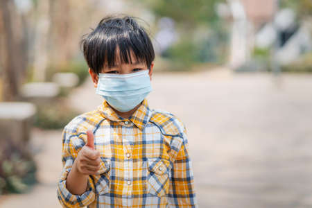 children boy wearing a mask to prevent dust and viruses
