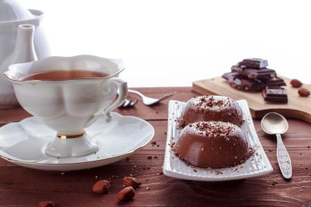 Vegan chocolate panna cotta with hazelnuts