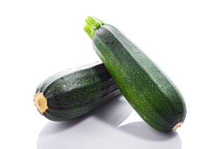 Zucchini or green marrow squash isolated on white background