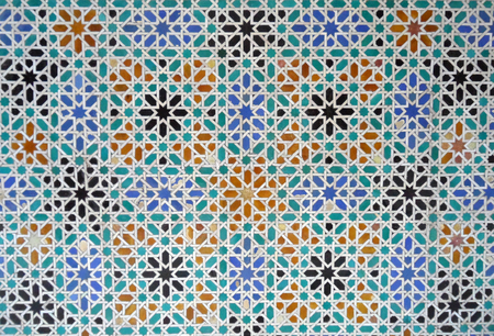 tiled wall: Brightly Color Moorish Style Tiled Wall in the Real alcazar of Seville in Spain, Background Stock Photo