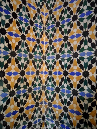 tiled wall: Brightly Color Moorish Style Tiled Wall in the Real alcazar of Seville in Spain, Background, Pattern