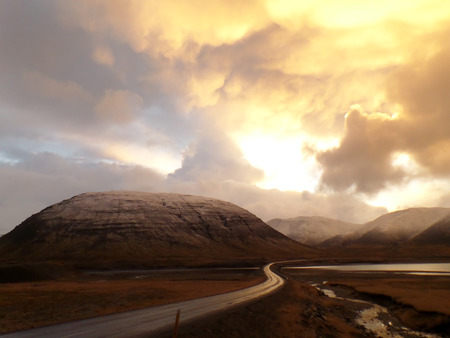 afterglow: Beautiful Golden Sunset Sky View on the way to Mount Kirkjufell, Iceland