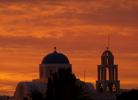 afterglow: Stunning Orange Gradation of the Sunset Afterglow over a Church in Santorini, Greece Stock Photo