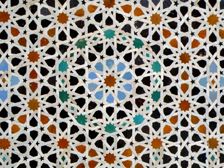 tiled wall: Moroccan Style Star Pattern Blue Orange Black Color Tiled Wall in Fez, Morocco, Background, Pattern Stock Photo