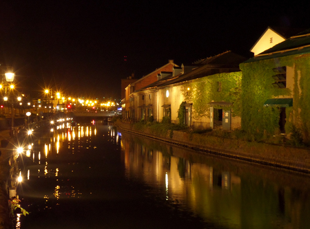 canal street: Reflection of the Old Warehouse and the Lighted up Street Lamp on Otaru Canal, Hokkaido, Japan