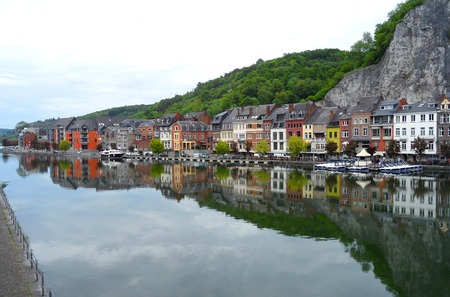 The Reflection of Colorful Traditional Architectures on the Meuse River in Dinant, Belgium