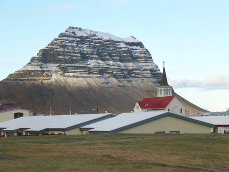 snow capped: Snow Capped Kirkjufell Mountain seen from the Town of Grundarfjordur, Iceland