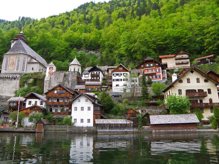 Scenic Traditional Waterfront Houses and Church on the Hallstatt Lake Shore, Austria