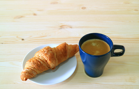 One Cup of Coffee with a Butter Croissant Served on Natural Wooden Table, with Free Space for Text or Design