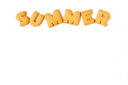 beige: Top view of the word SUMMER, made with alphabet shaped biscuits isolated on white background, with free space for design and text