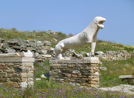 ancient lion: Ancient lion statue against the sunny sky, Archaeological Site of Delos, Delos Island, Mykonos, Greece